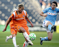 Chicago Red Star forward Karen Carney (14) leaps to stop a clearance by Sky Blue FC defender Christie Shaner (18).  The Sky Blue FC defeated the Chicago Red Stars 2-0 at Toyota Park in Bridgeview, IL on May 10, 2009.