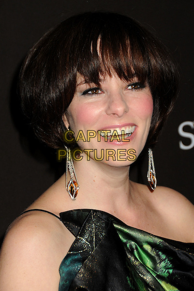 PARKER POSEY .Attending the 12th Annual Costume Designers Guild Awards held at the Beverly Hilton Hotel.  .Beverly Hills, California, USA,  .25th February 2010 .arrivals portrait headshot fringe dangly earrings green smiling mouth open one shoulder .CAP/ADM/BP.©Byron Purvis/AdMedia/Capital Pictures.