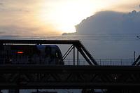 Tempe, Arizona. Tempe Town Lake at sunset shows the Light Rail going through a bridge. Photo by Eduardo Barraza © 2015