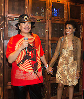 LAS VEGAS, NV - SEPTEMBER 12: Carlos Santana and Cindy Blackman Santana pictured as Carlos Santana Kicks off fall residency shows at House of Blues Las Vegas and honored with a Casa Noble tequila Locker at The Foundation Room at House of Blues in Las Vegas, NV on September 12, 2012. &copy; RD/Kabik/ Starlitepics/MediaPunch Inc.***HOUSE COVERAGE*** /NortePhoto.com<br />