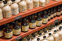 Jugs of maple syrup in a general store, Vermont, USA
