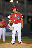 Harrisburg Senators pitcher Nick Lee (14) looks in for the sign during a game against the New Hampshire Fisher Cats on July 21, 2015 at Metro Bank Park in Harrisburg, Pennsylvania.  New Hampshire defeated Harrisburg 7-1.  (Mike Janes/Four Seam Images)