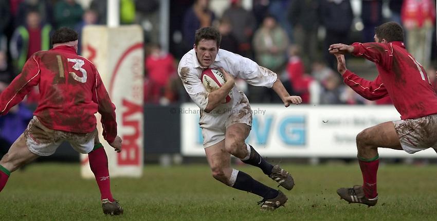 Photo. Richard Lane. .Wales U21 v England U21 at Sardis Road, Pontypridd, Wales. 2/2/2001.Sam Cox attacks.