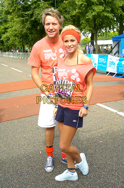 BEN LUNT & LIANNE DAUBAN (Shipwrecked).BUPA Great Capital 10 K Fun Run, Hyde Park,.London, England, July 15th 2007..full length red t-shirt race runners trainers headband hairband sporty.CAP/CAN.©Can Nguyen/Capital Pictures