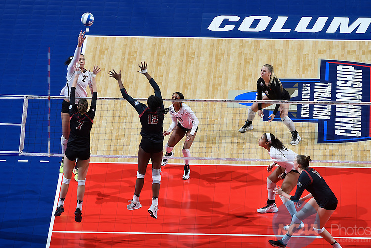 COLUMBUS, OH - DECEMBER 17:  Ebony Nwanebu (2) of the University of Texas hits a dink against Stanford University during the Division I Women's Volleyball Championship held at Nationwide Arena on December 17, 2016 in Columbus, Ohio.  Stanford defeated Texas 3-1 to win the national title. (Photo by Jamie Schwaberow/NCAA Photos via Getty Images)