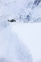 A British Merlin helicopter about to touch down during practice in the Arctic, in the mountains near Bardufoss, Norway. <br /> <br /> In 2019 the Arctic exercise Clockwork passed 50 years of training in Norway, and now has a permanent base within the Norwegian Air Force base at Bardufoss. <br /> <br /> 845 Naval Air Squadron is a squadron of the Royal Navy's Fleet Air Arm. Part of the Commando Helicopter Force, it is a specialist amphibious unit operating the Leonardo Commando Merlin Mk3 helicopter and provides troop transport and load lifting support to 3 Commando Brigade Royal Marines.<br /> <br /> ©Fredrik Naumann/Felix Features