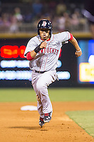 Mookie Betts (12) of the Pawtucket Red Sox hustles towards third base against the Charlotte Knights at BB&T Ballpark on August 9, 2014 in Charlotte, North Carolina.  The Red Sox defeated the Knights  5-2.  (Brian Westerholt/Four Seam Images)