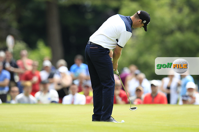 Michael Hoey (NIR) putts on the 9th green during Friday's Round 2 of the 2014 Irish Open held at Fota Island Resort, Cork, Ireland. 20th June 2014.<br /> Picture: Eoin Clarke www.golffile.ie