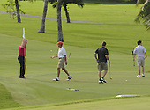 Kailua, Hawaii - December 29, 2008 -- United States President-elect Barack Obama (second from left) tosses his golf ball after putting on the ninth hole during golf with friends in Kailua, Hawaii on Monday, December 29, 2008. Obama and his family arrived in his native Hawaii December 20 for the Christmas holiday..Credit: Joaquin Siopack - Pool via CNP
