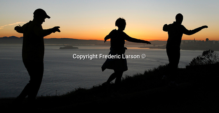 A group of exercise enthusiasts bounce their way on a small trail leading up to the Golden gate Bridge, in the Marin headlands, California