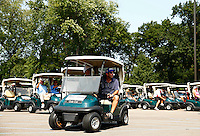 Participants line up in their golf carts prior to the start of the 5th annual Jalen Rose Leadership Academy golf tournament at the Detroit Golf Club in Detroit, Michigan on Monday August 31, 2015. (Photo by Jared Wickerham/The Players Tribune)