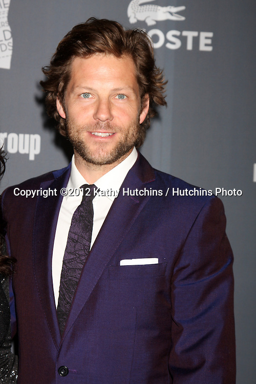 LOS ANGELES - FEB 21:  Jamie Bamber arrives at the 14th Annual Costume Designers Guild Awards at the Beverly Hilton Hotel on February 21, 2012 in Beverly Hills, CA.