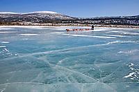 Robert Sorlie runs on a frozen tundra lake between Unalakleet and Shaktoolik