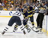 Blake Kessel (UNH - 20), Mike Collins (Merrimack - 13), Chris Millea - The Merrimack College Warriors defeated the University of New Hampshire Wildcats 4-1 (EN) in their Hockey East Semi-Final on Friday, March 18, 2011, at TD Garden in Boston, Massachusetts.