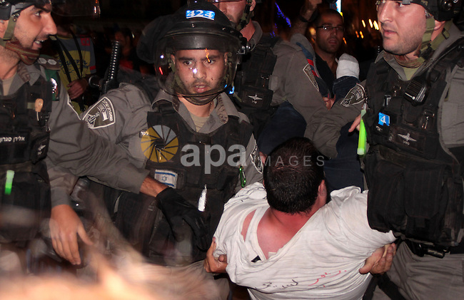 Israeli security forces clash with Palestinian protestors outside the Damascus gate in Jerusalem on July 15, 2013 during a demonstration against the Israeli government's plans to relocate Bedouins in the Negev desert. Thousands of Bedouins demonstrated, notably in the southern city of Beersheva, to protest against a government project they say will displace tens of thousands of people from their land. There are around 260,000 Bedouin in Israel, mostly living in and around the Negev in the arid south. Photo by Saeed Qaq