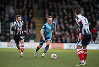 Garry Thompson of Wycombe Wanderers chased by Jamey Osborne of Grimsby Town during the Sky Bet League 2 match between Grimsby Town and Wycombe Wanderers at Blundell Park, Cleethorpes, England on 4 March 2017. Photo by Andy Rowland / PRiME Media Images.