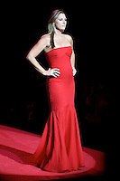 2/13/09 - Photo by John Cheng.  Daisy Fuentes walks down the runway at the Red Dress Collection Fashion Show in Bryant Park, New York.  February is National Heart Month, and the fashion show is part of the month-long activities to raise women?s heart disease awareness.