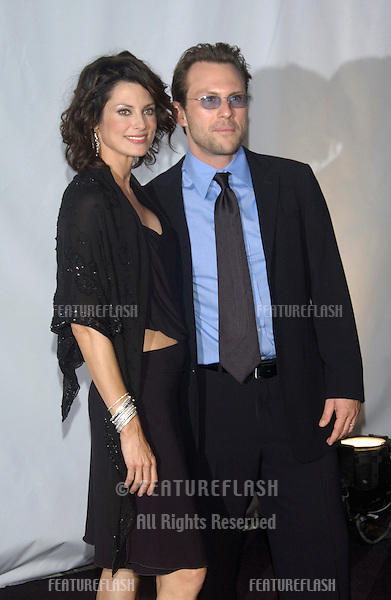 Actor CHRISTIAN SLATER & wife RYAN HADDON at fashion show event on Rodeo Drive, Beverly Hills, where designer Giorgio Armani was honored with the first Rodeo Drive Walk of Style Award..Sept 9, 2003