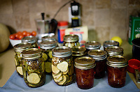 Finished jars of pickles and peach jam cool after a canning and pickling class at the home of Wall Street Journal reporter Ana Campoy (cq) taught by personal canning coach Kelly Ingram (cq) in Dallas, Texas, USA, Saturday, Sept. 12, 2009. Growing produce or buying locally grown vegetables and canning at home is a fun and healthy way to keep grocery costs down...CREDIT: Matt Nager for The Wall Street Journal
