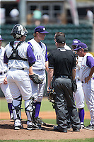 Winston-Salem Dash starting pitcher Jace Fry (11) is checked on by trainer Josh Fallin and manager Tim Esmay (right) after hurting his left elbow during the game against the Salem Red Sox at BB&T Ballpark on May 31, 2015 in Winston-Salem, North Carolina.  The Red Sox defeated the Dash 6-5.  (Brian Westerholt/Four Seam Images)