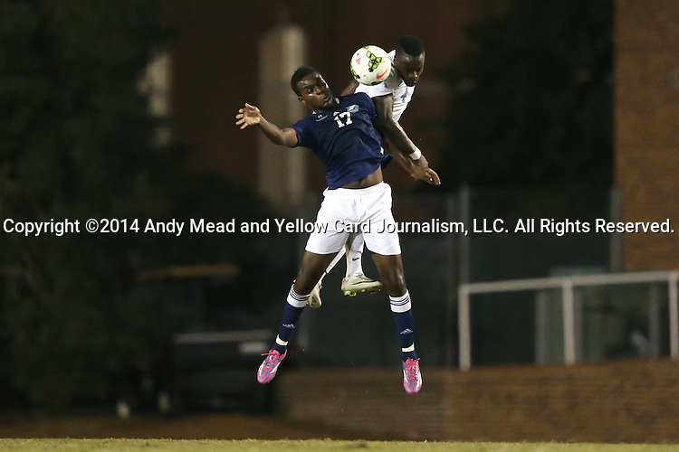 28 October 2014: North Carolina's Boyd Okwuonu (behind) heads the ball over Georgia Southern's Emmanuel Raji (17). The University of North Carolina Tar Heels hosted the Georgia Southern University Eagles at Fetzer Field in Chapel Hill, NC in a 2014 NCAA Division I Men's Soccer match. North Carolina won the game 6-2.
