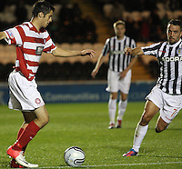 Stephen Hendrie being closed down by Dougie Imrie in the St Mirren v Hamilton Academical Scottish Communities League Cup match played at St Mirren Park, Paisley on 25.9.12.
