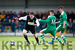 No 8 Killarney Celtic goes on a mazy run against Boyle Celtic  during their FAI cup clash in Killarney on Saturday