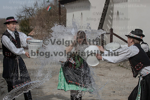 "Girls run as boys throw water at them as part of traditional Easter celebrations, during a media presentation in Holloko, 100 km (62 miles) east of Budapest, Hungary on March 28, 2012..Locals from the World Heritage village of Holloko, celebrate Easter with the traditional ""watering of the girls"", a Hungarian tribal fertility ritual rooted in the area's pre-Christian past. ATTILA VOLGYI"