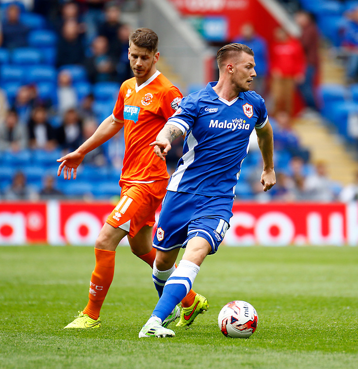 Cardiff City's Anthony Pilkington in action during todays match  <br /> <br /> Photographer Simon King/CameraSport<br /> <br /> Football - The Football League Sky Bet Championship - Cardiff City v Blackpool - Saturday 25th April 2015 - Cardiff City Stadium - Cardiff<br /> <br /> &copy; CameraSport - 43 Linden Ave. Countesthorpe. Leicester. England. LE8 5PG - Tel: +44 (0) 116 277 4147 - admin@camerasport.com - www.camerasport.com