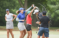 Fellow golfers pour water on Maria Fassi, Saturday, June 27, 2020 during the final round of the WAPT pro golf tournament in Bella Vista. Check out nwaonline.com/200627Daily/ for today's photo gallery. <br /> (NWA Democrat-Gazette/Charlie Kaijo)