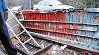 BNPS.co.uk (01202 558833)<br /> Pic: RobertMorley/BNPS.<br /> <br /> Robert Morley completed stripped back the boat to its ribs and mahogany hull.<br /> <br /> The world's first drone boat is rediscovered - after 100 years in the shadows.<br /> <br /> A historic British torpedo boat, which was converted into the world's first remotely controlled 'drone vessel' as part of a top secret project at the end of the Great War has been painstakingly researched and restored after being discovered rotting in a West country boatyard.<br /> <br /> The pioneering CMB9/DCB1 was one of 12 Coastal Motor Boats (CMBs) built by the Admiralty in 1916 to target German destroyers.<br /> <br /> The fast, lightweight 40ft motor torpedo boat, which could travel at 40 knots, sunk the German destroyer G88 off Zebrugge in Belgium in 1917.<br /> <br /> Subsequently, it was one of four vessels converted into Distance Control Boats (DCBs) for top secret trials to see if unmanned patrol boats with torpedoes could be radio controlled via aircraft and directed towards enemy targets.<br /> <br /> The boat was found in a sorry state covered in brambles in a boat yard in Weston-super-Mare, Somerset, by marine surveyor Robert Morley a decade ago, who has spent tens of thousands of pounds restoring and researching it's colourful history.