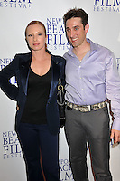 "TRACI LORDS & PAUL J. ALESSI, producer/actor.""Knuckle Draggers"" Premiere at the 2009 Newport Beach Film Festival held at Edwards Cinemas, Newport Beach, CA, USA..April 27th, 2009.half length black purple grey gray shirt trousers jacket tracey tracy blue silk satin hand on hip.CAP/ADM/BP.©Byron Purvis/AdMedia/Capital Pictures."