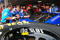 May 31, 2008; Dover, DE, USA; Nascar Sprint Cup Series driver Ryan Newman (right) talks with crew chief Roy McCauley during practice for the Best Buy 400 at the Dover International Speedway. Mandatory Credit: Mark J. Rebilas-US PRESSWIRE