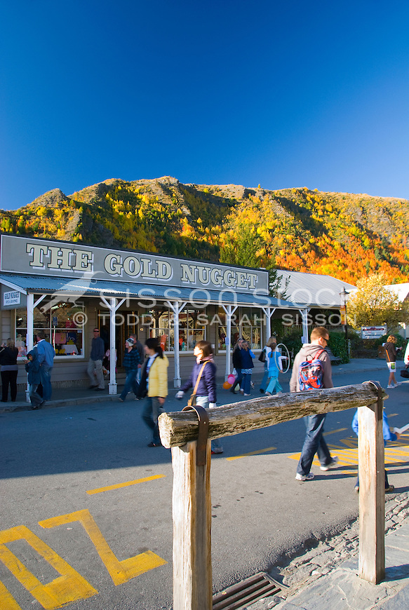 Souvenir shop and hitching post in historic Arrowtown with Autumn trees behind, Central Otago, South Island, New Zealand