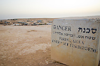 Some unrecognized Bedouin villages in the Negev are within Israeli military testing grounds. The villages were here first - but they dont appear on any maps, so officially don't exist and didn't need to be considered when the testing grounds were created. Residents of these villages have been killed accidentally by explosives.