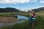 engagement portrait of Julie and Adam along the Big Thompson River in Moraine Park, morning in Rocky Mountain National Park, Colorado , USA