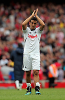 Pictured: Neil Taylor of Swansea is thanking away supporters after the final whistle. Saturday 10 September 2011<br />