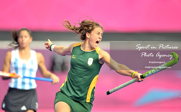 Dirkie Chamberlain (South Africa) celebrates scoring. ARG Vs RSA. Womens Hockey - PHOTO: Mandatory by-line: Garry Bowden/SIP/Pinnacle - Photo Agency UK Tel: +44(0)1363 881025 - Mobile:0797 1270 681 - VAT Reg No: 768 6958 48 - 29/07/2012 - 2012 Olympics - River Bank Arena, London, England.