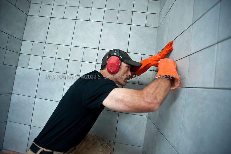 9/20/2011--Seattle, WA, USA..Climber Chad Kellogg working as a contractor on a home in West Seattle, WASH. Kellogg, 39, is training for the world speed record climb on Mt. Everest that he will attempt in May, 2012. Kellogg climbs solo and without oxygen...A former competitive luger, Kellogg is a Buddhist who wakes everyday at 4 a.m. to meditate before heading out for training and work. A few years ago, Kellogg had part of his colon removed because of cancer and also lost his first wife to a climbing accident...©2011 Stuart Isett. All rights reserved.