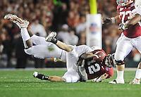 Jan 7, 2010; Pasadena, CA, USA; Alabama Crimson Tide quarterback Greg McElroy (12) is sacked by a Texas Longhorns defender during the second quarter of the 2010 BCS national championship game at the Rose Bowl.  Mandatory Credit: Mark J. Rebilas-