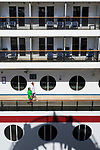 View of all the balcony cabins and shadow of green thunder water-slide on-board Carnival cruise ship whilst it was berthed at the Overseas Passenger Terminal in Sydney, NSW, Australia
