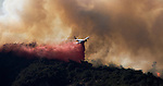 A brush fire in Los Angeles' historic Griffith Park burned over 600 plus acres of decades old brush. Extremely hot temperatures and single digit humidity made the fire burn out of control for several hours. Water dropping helicopters from LA County Fire and water dropping fixed wing aircraft helped to douse the blaze..The fire may have been started by arson.