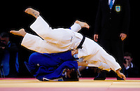 04 DEC 2011 - LONDON, GBR - Karine Berger (FRA) (in blue, on bottom) throws Maria Portela (BRA) (in white, on top) during the London International Judo Invitational and 2012 Olympic Games test event at the ExCel Exhibition Centre in London, Great Britain .(PHOTO (C) NIGEL FARROW)