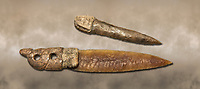 Brown obsidian dagger with a bone handle carved into the shape of a snake. It is believed this may have been a ritual dagger. Catalhoyuk Collections. Museum of Anatolian Civilisations, Ankara