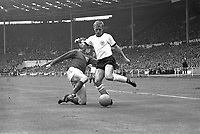 30.07.1966. Wembley Stadium, London England. 1966 World Cup final England versus Germany (4-2) After Extra time.  Jack Charlton (L, ENG) tackles Sigfried Held (GER).