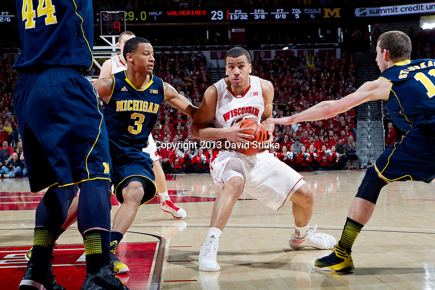 Wisconsin Badgers guard Traevon Jackson (12) handles the ball during a Big Ten Conference NCAA college basketball game against the Michigan Wolverines Saturday, February 9, 2013, in Madison, Wis. The Badgers won 65-62 (OT) (Photo by David Stluka)