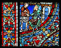 The younger son has nothing left and goes to see a wealthy man who gives him a job feeding his pigs in the fields, from the Parable of the Prodigal Son stained glass window, in the north transept of Chartres Cathedral, Eure-et-Loir, France. This window follows the parable as told by St Luke in his gospel. It is thought to have been donated by courtesans, who feature in 11 of the 30 sections. Chartres cathedral was built 1194-1250 and is a fine example of Gothic architecture. Most of its windows date from 1205-40 although a few earlier 12th century examples are also intact. It was declared a UNESCO World Heritage Site in 1979. Picture by Manuel Cohen