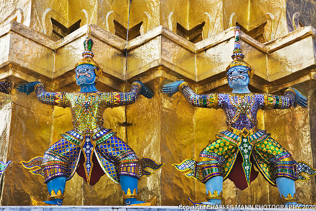 Guardian demons surrounding a golden stupa at the Grand Palace, Ko Rattanakosin in Bangkok.