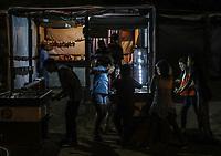 Varias ni&ntilde;asy ni&ntilde;os se divierten  juegando futbol o futbolito de mesa, durante una de las noches de celebraciones de cuaresma, Semana Santa en la colonia Coloso Alto ...<br /> Several girls and boys have fun playing soccer or table football, during one of the nights of Lenten celebrations, Holy Week in Coloso Alto colony ...<br /> (Photo:Luis Gutierrez/NortePhoto)