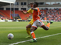 Blackpool's Marc Bola crosses the ball despite the attentions of Fleetwood Town's Wes Burns<br /> <br /> Photographer Stephen White/CameraSport<br /> <br /> The EFL Sky Bet League One - Blackpool v Fleetwood Town - Monday 22nd April 2019 - Bloomfield Road - Blackpool<br /> <br /> World Copyright © 2019 CameraSport. All rights reserved. 43 Linden Ave. Countesthorpe. Leicester. England. LE8 5PG - Tel: +44 (0) 116 277 4147 - admin@camerasport.com - www.camerasport.com